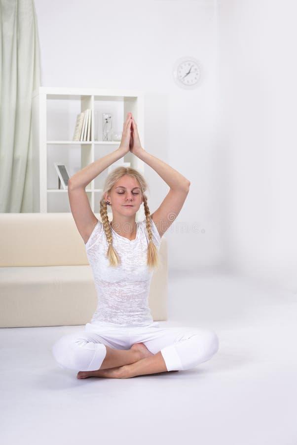 Girl in lotus pose royalty free stock photo