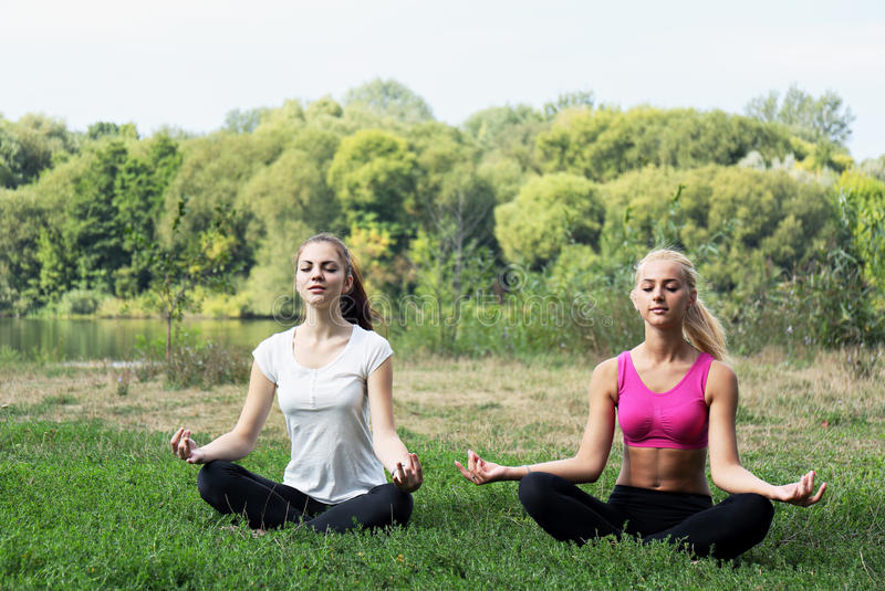Girl in the lotus position stock photography
