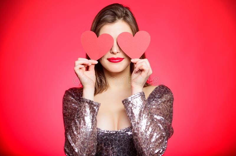 Girl in love dating. Obsession concept. Fall in love. Girl adorable fashion model makeup face hold heart valentines card. Love from first sight. Woman in royalty free stock image