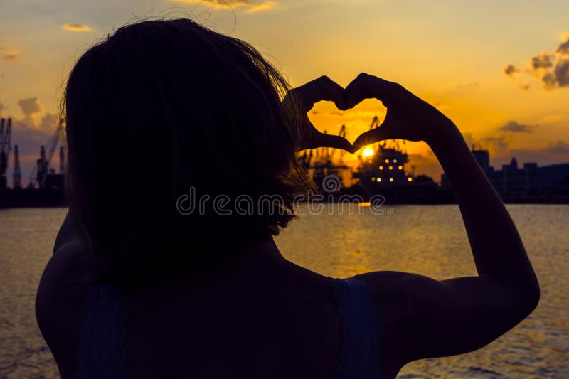 Girl in love enjoying tender moments at sunset during holiday with best friends. Emotional concept of happy exclusive. Lifestyle moment, sharing time, relaxing royalty free stock photo