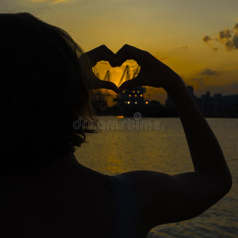Girl in love enjoying tender moments at sunset during holiday. Emotional concept of happy exclusive lifestyle moment. Girl in love enjoying tender moments at royalty free stock photography
