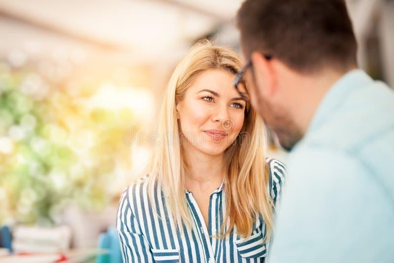Girl in love looks at her boyfriend stock image
