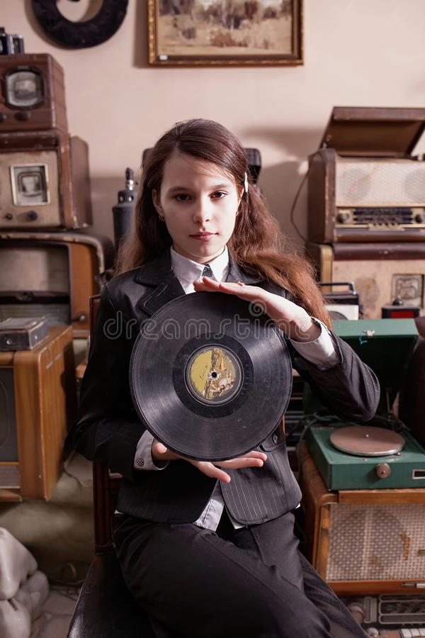 Girl with LP record in antique shop stock image