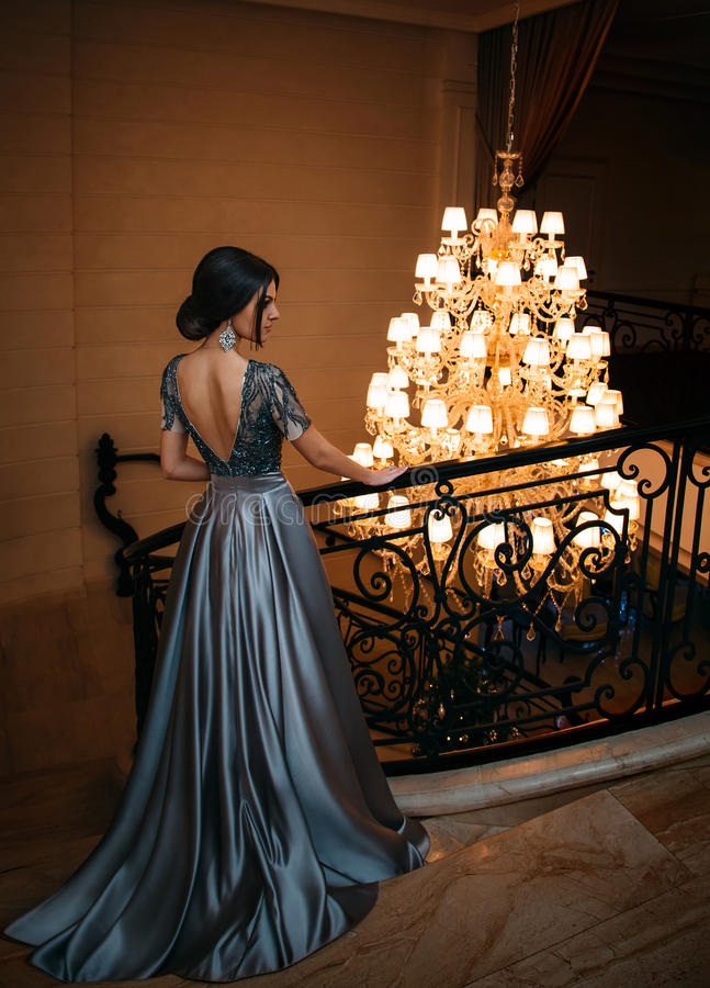 Girl in a luxurious, evening dress royalty free stock image