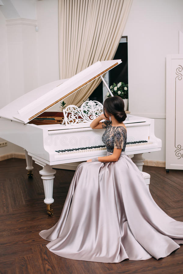 Girl in a luxurious, evening dress royalty free stock photos