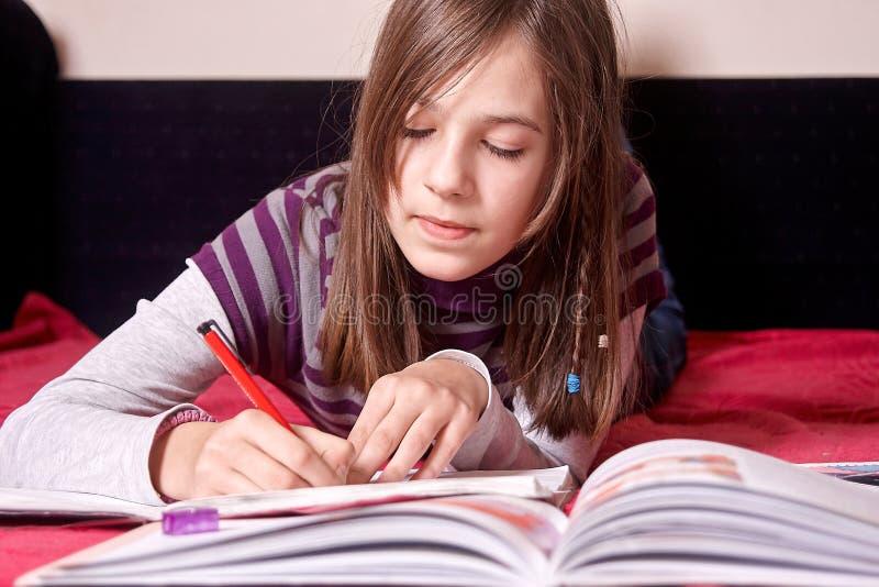 Girl doing homework stock photos
