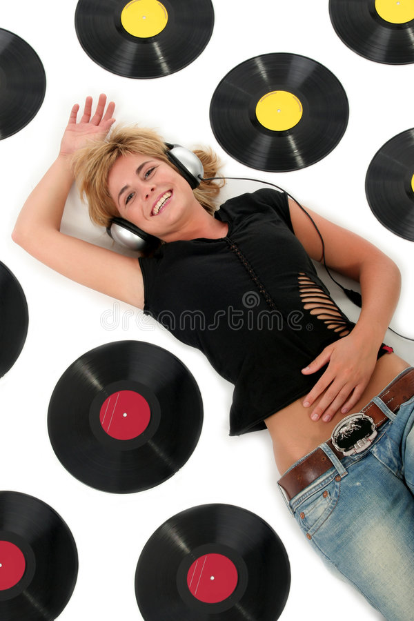 Girl lying down with vinyl records stock photography