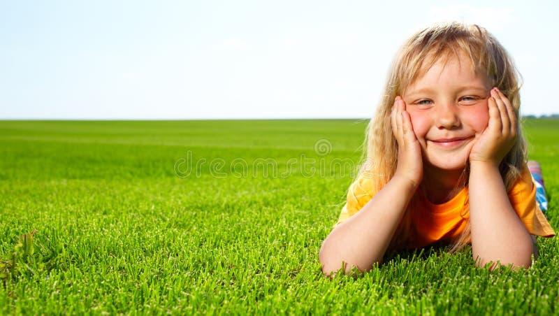 Girl lying in field stock photos