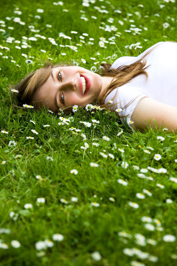 Girl lying on the grass royalty free stock photo
