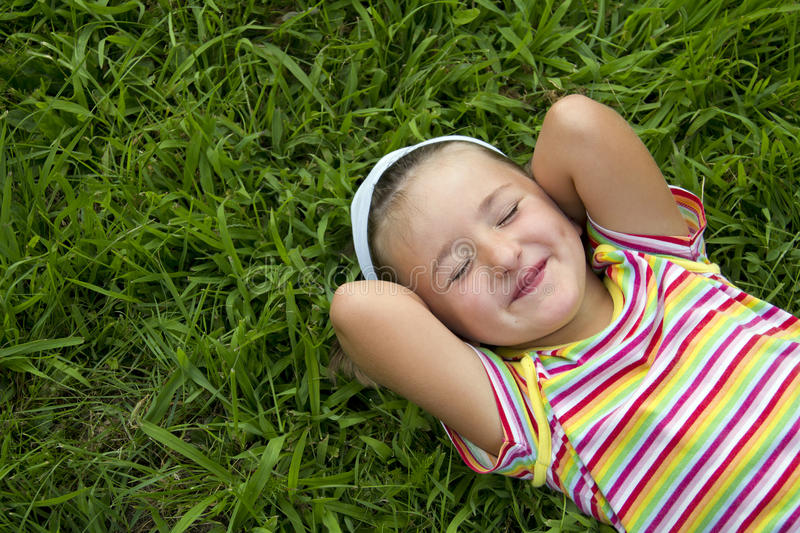 Download Girl lying in grass stock image. Image of leisure, outdoor - 25863353