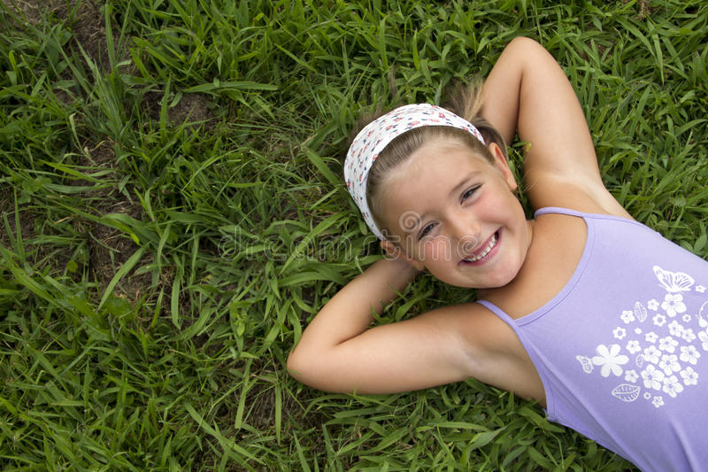 Download Girl lying in grass stock image. Image of lying, flare - 25863387