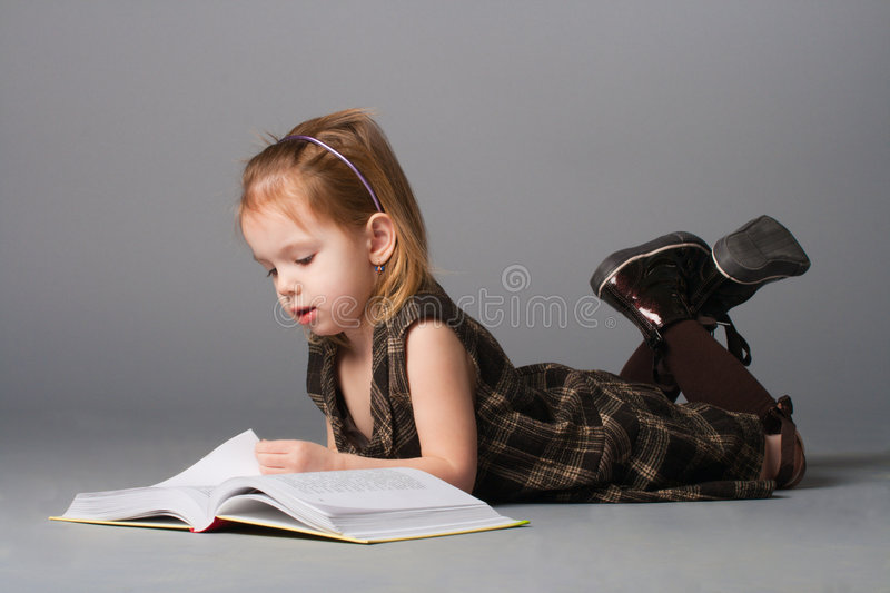 Download Girl lying and reading. stock photo. Image of look, offspring - 8874614