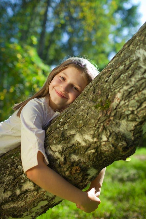 Girl lying on a tree