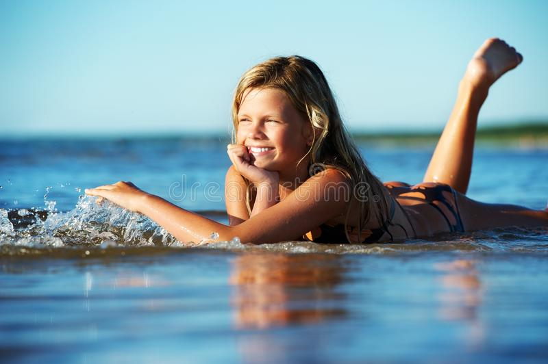 Download Girl lying in the water stock image. Image of portrait - 17208673
