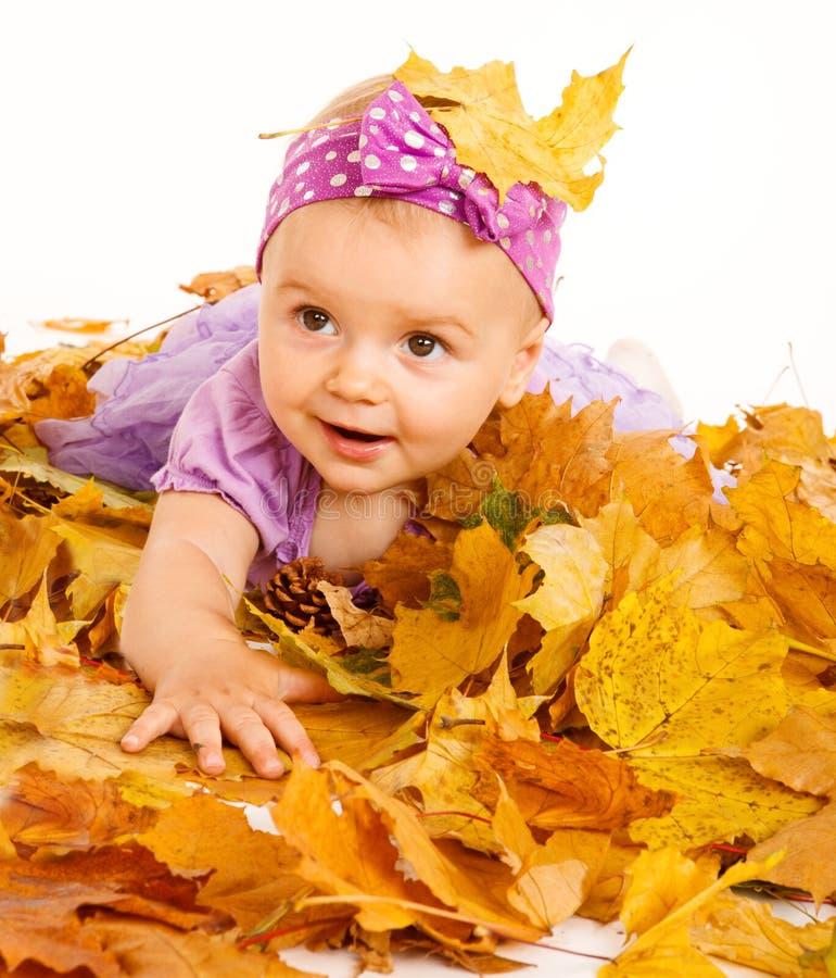 Girl lying on yellow leaves stock photo
