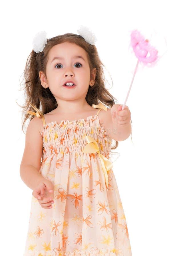 Girl with magic wand stock photo