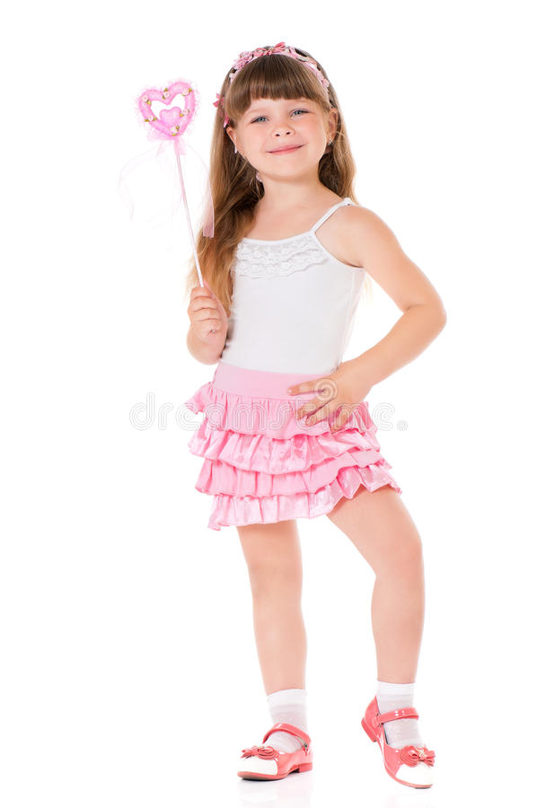 Girl with magic wand. Happy little girl with magic wand, isolated on white background royalty free stock photography