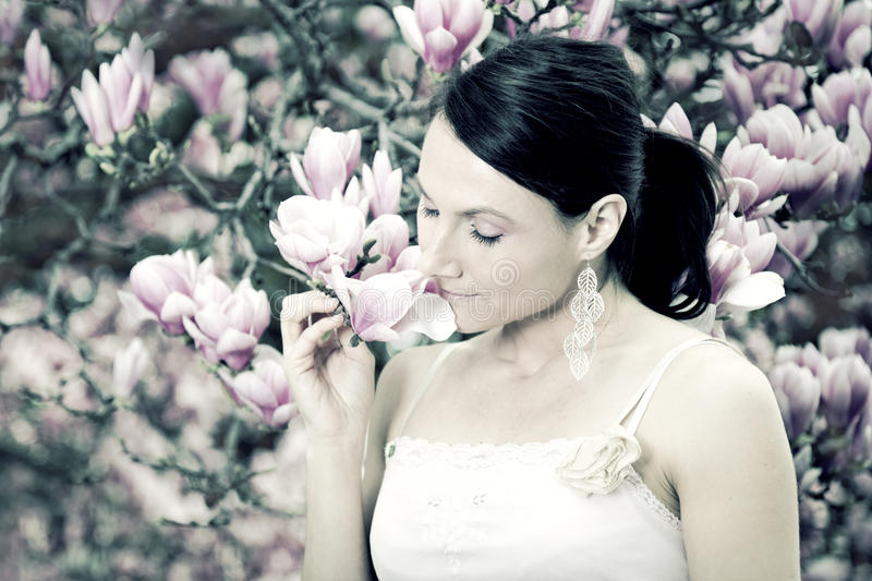 Girl And Magnolia Flowers Stock Image