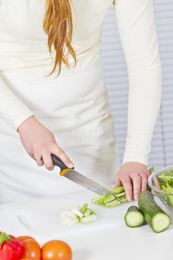 Girl Make a Healthy Salad royalty free stock photos