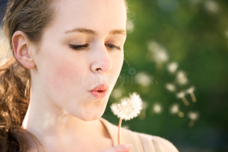 Girl make a wish stock photography