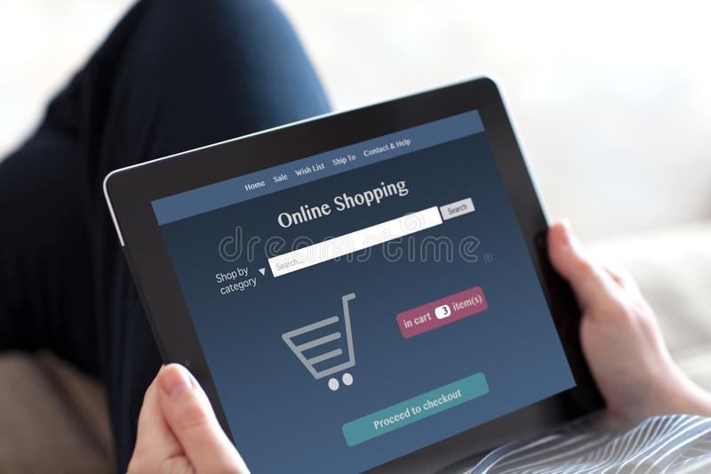 Girl makes online shopping on a tablet royalty free stock images