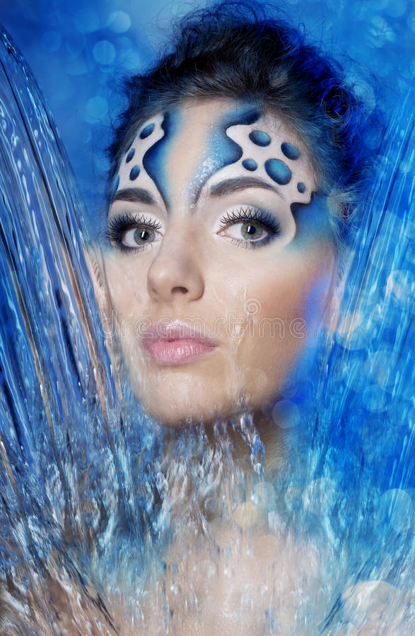 Girl with makeup in the form of water and bubbles. The image of a girl with makeup in the form of water and bubbles royalty free stock photography