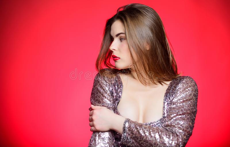 Girl makeup lips posing over red background. Makeup for party. Get ready for public event or party celebration. Attractive and confident woman with makeup royalty free stock images