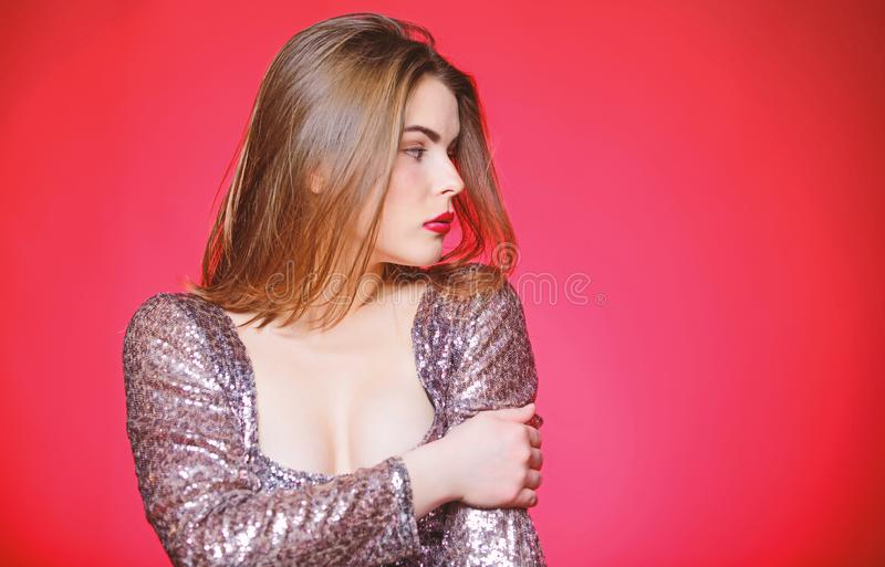 Girl makeup lips posing over red background. Makeup for party. Get ready for public event or party celebration. Attractive and confident woman with makeup royalty free stock photos