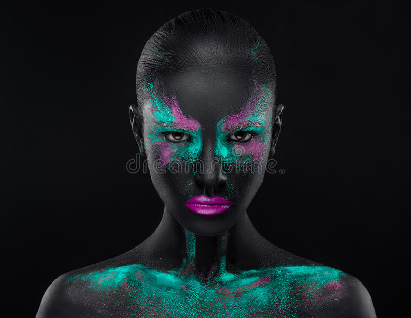 Girl Makeup pink blue black eye colors space. Studio stock photos