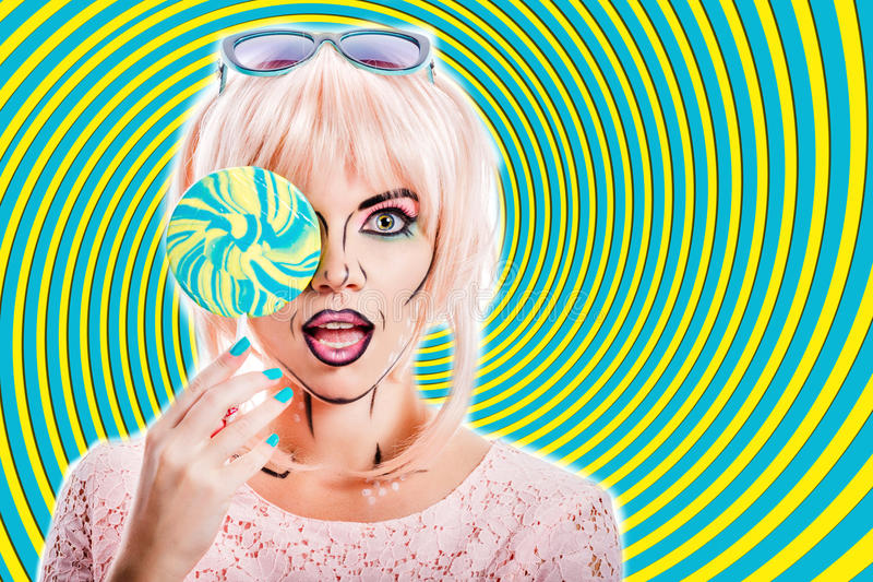 Girl with makeup in the style of pop art and lollipop. Color background. Girl with creative makeup in the style of pop art holding lollipop and hides her face stock photo