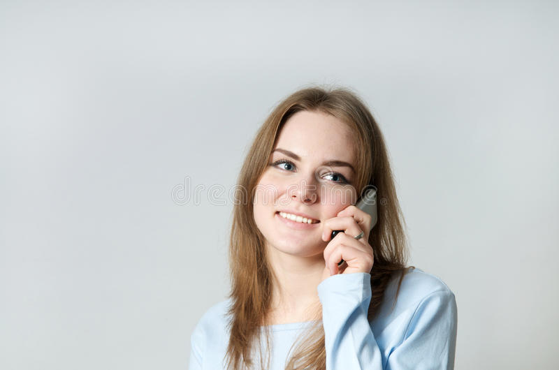 Girl making a call stock photos