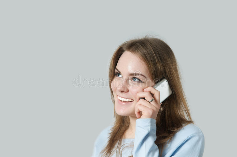 Girl making a call stock photography
