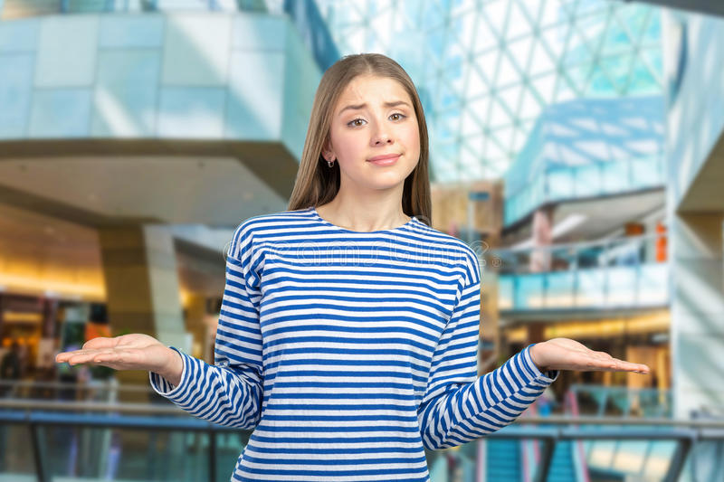Girl making do not know sign stock images
