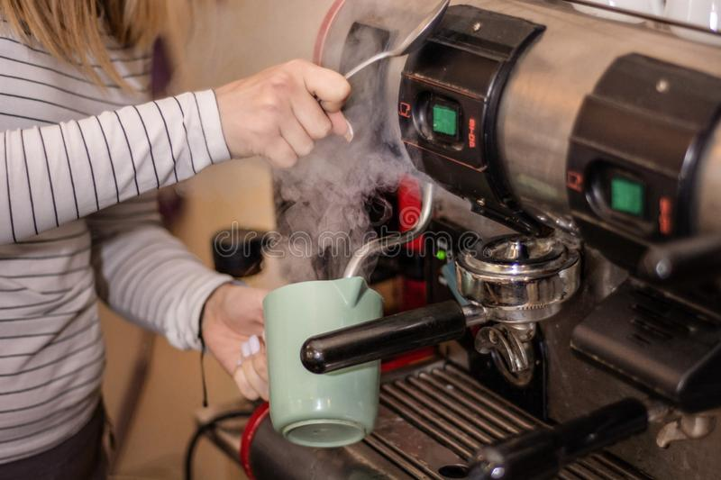 Girl making espresso coffee on a professional machine in the bar royalty free stock photos