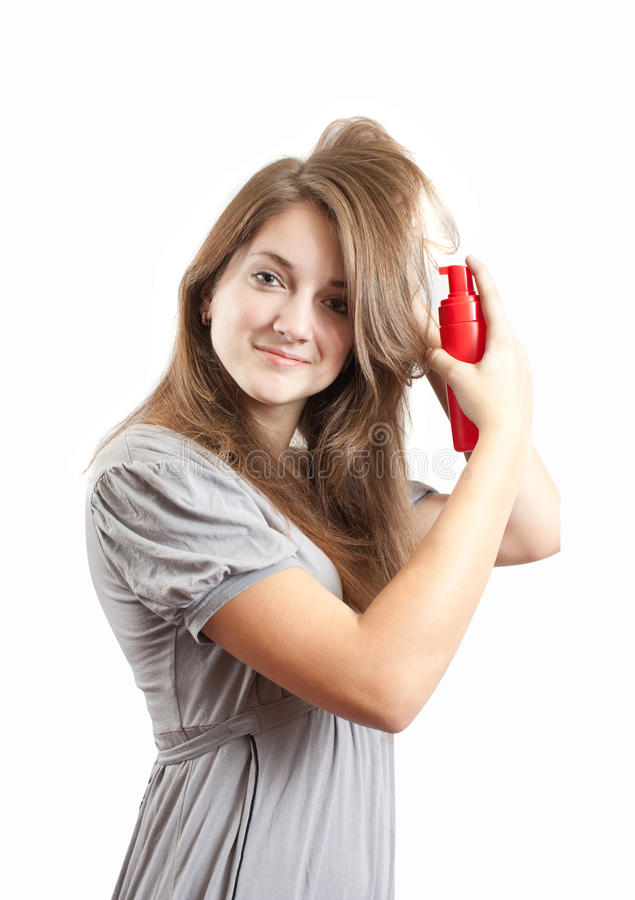Girl making a hairdo. Young model with styling mousse. Making a hairdo stock photo
