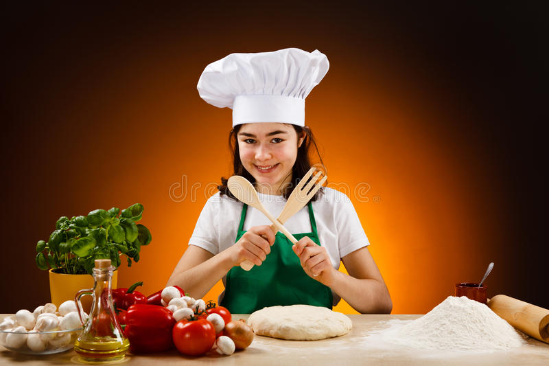 Girl making pizza dough royalty free stock photo