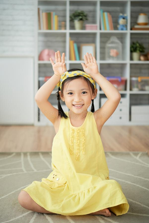 Girl making rabbit ears royalty free stock image