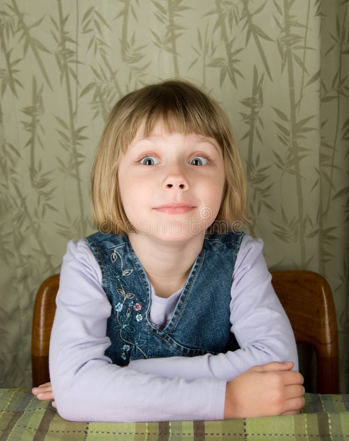 Girl making silly face. Girl poses and makes a silly expression for the camera royalty free stock photo