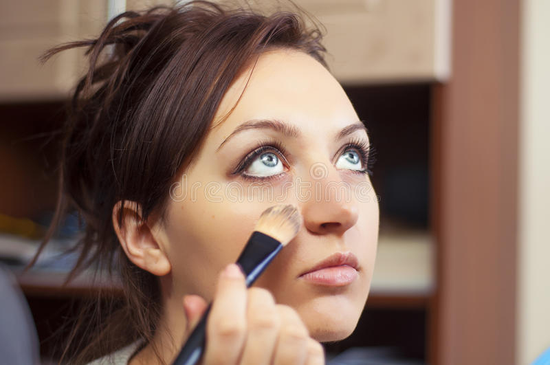 Girl making up. An image of girl making up stock image