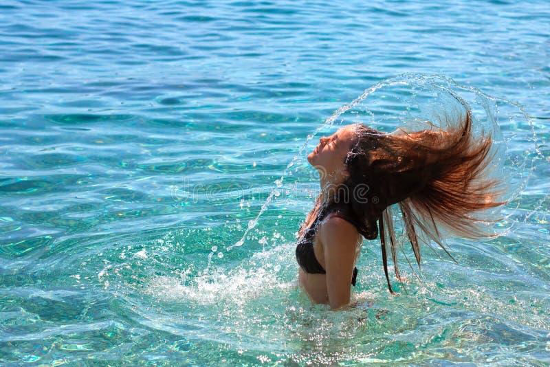 Girl making water splash