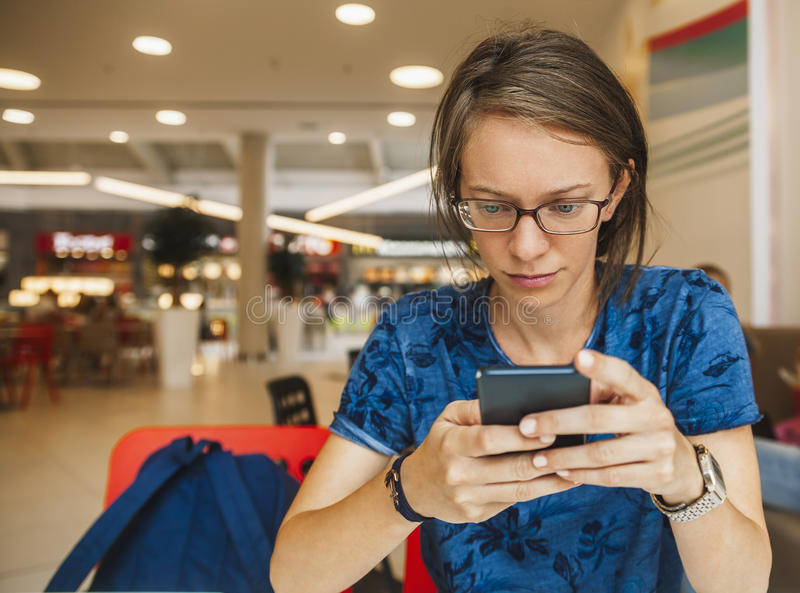 Girl At The Mall. Girl Using Mobile Phone At The Mall stock photo