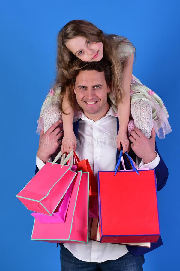 Girl and man with happy faces hold shopping bags stock photography