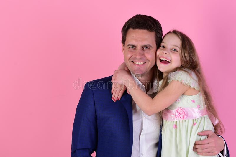 Girl and man with happy smiling faces on pink background royalty free stock image