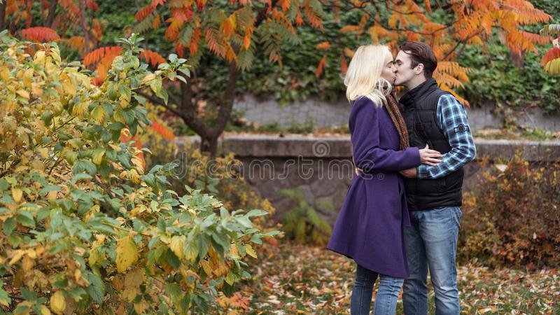 Girl and man or lovers on date hug stock photo