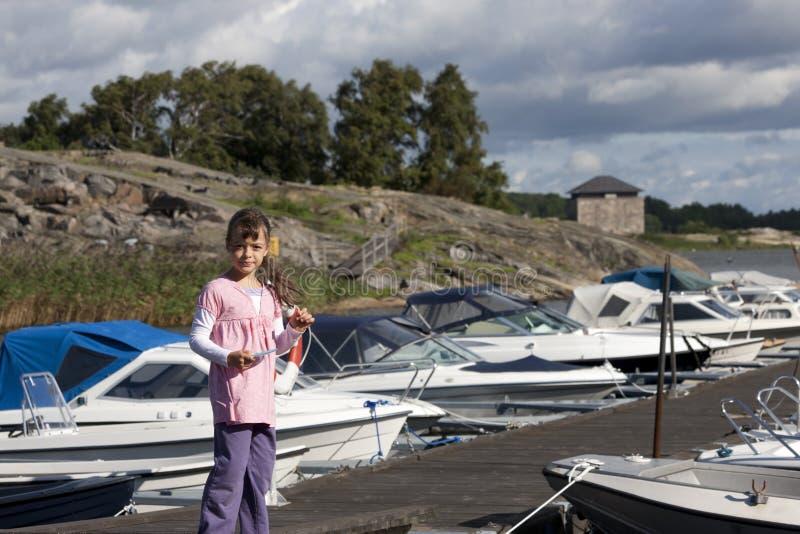 Girl on the marina. Young girl at the marina stock photos
