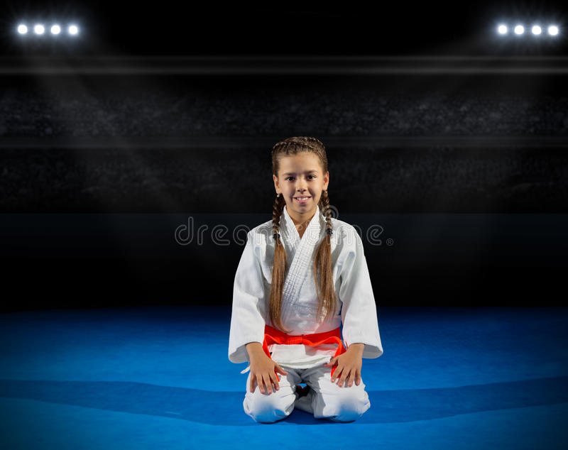 Girl martial arts fighter. In sports hall royalty free stock images