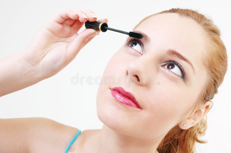 Girl with mascara royalty free stock image