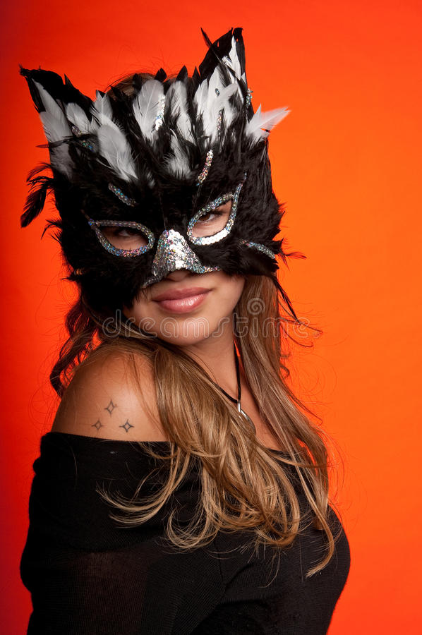 Girl in the mask. Young caucasian girl wearing a cat mask royalty free stock image