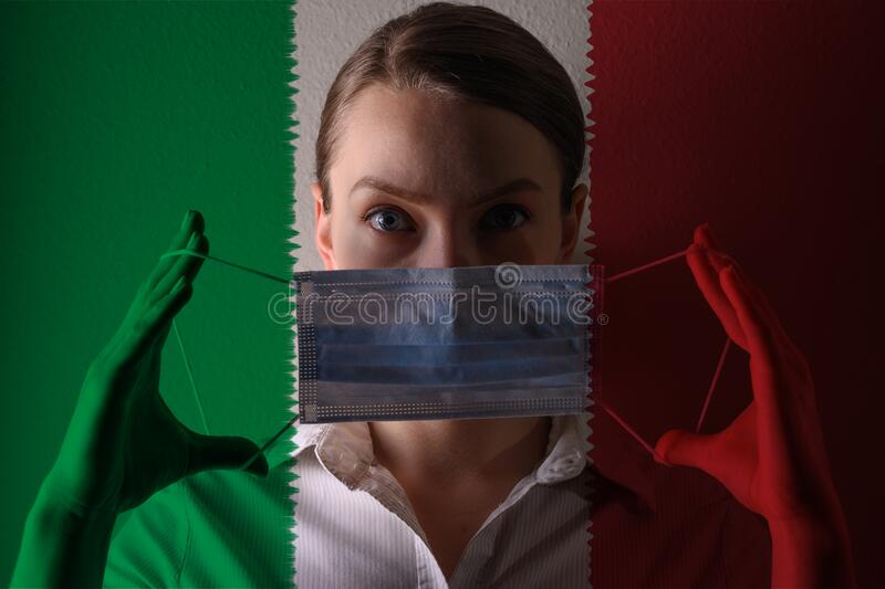 Girl in a mask against the background of the Italy flag, coronavirus, danger and threat, outbreak of a dangerous virus. Photo for. Articles, news royalty free stock image