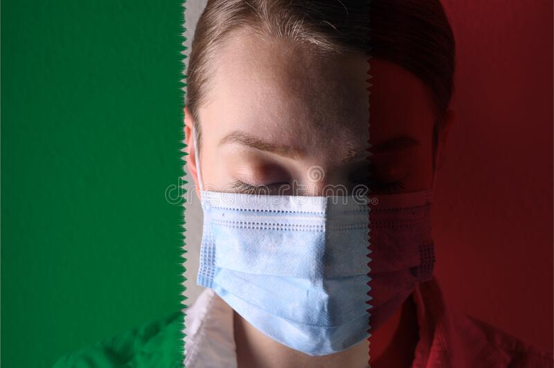 Girl in a mask against the background of the Italy flag, coronavirus, danger and threat, outbreak of a dangerous virus. Photo for. Articles, news stock photos